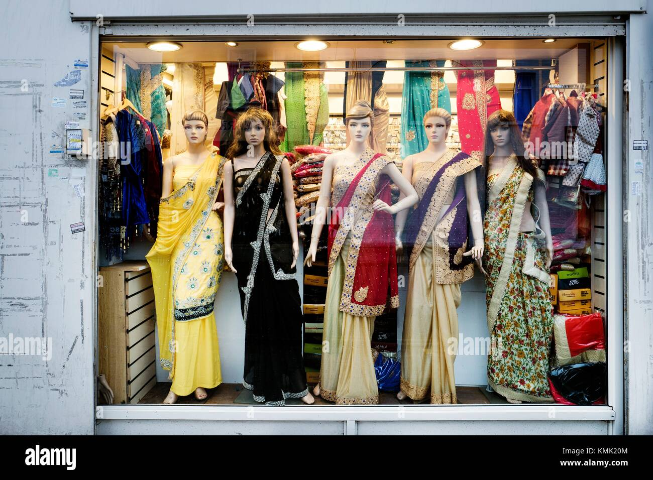 3692ac73c43 Indian fashion store. Shop window with female mannequins in Indian clothes.  Glass reflections.