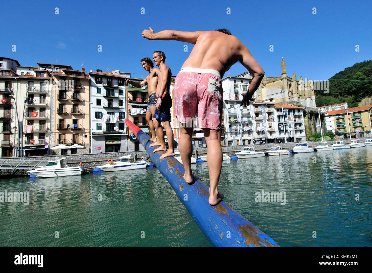 Cucaña (spanish), Greasy pole, grease pole or greased pole refers to a pole that has been made slippery and - Stock Image