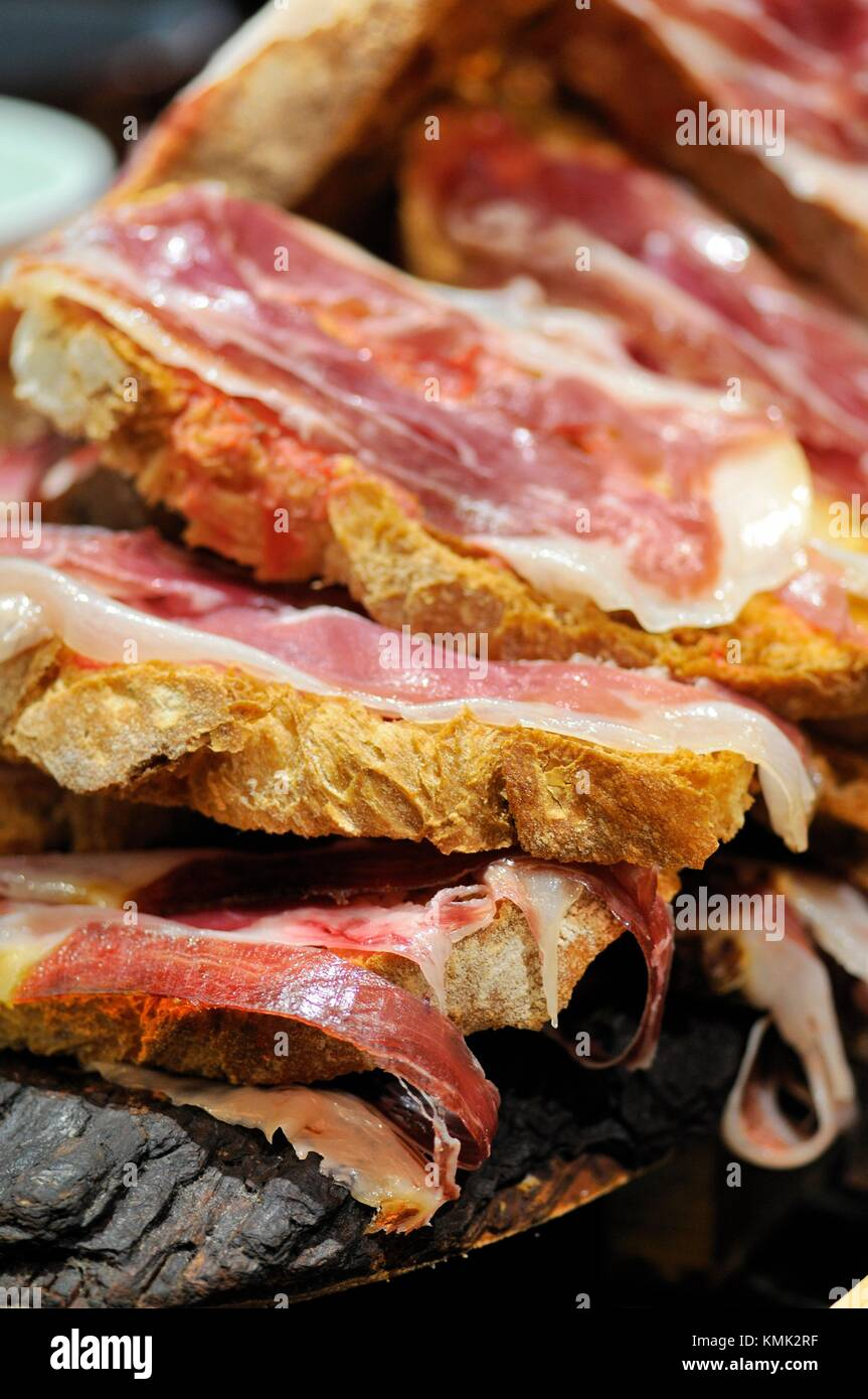 Ham with bread, Pintxos, also called tapas very typical at Basque country, Bilbao bar, North of Spain. - Stock Image