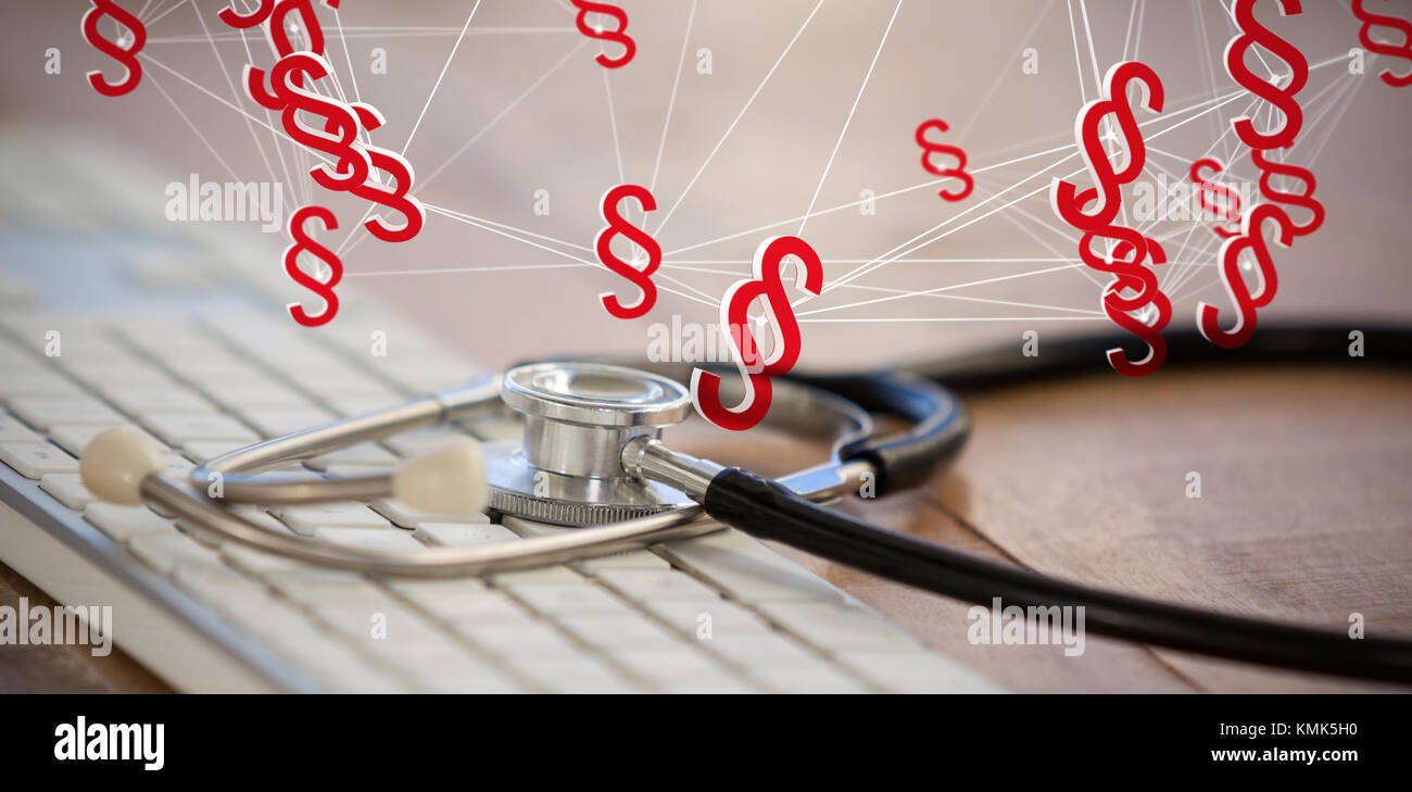 Vector icon of section symbol against close-up of keyboard with stethoscope Stock Photo