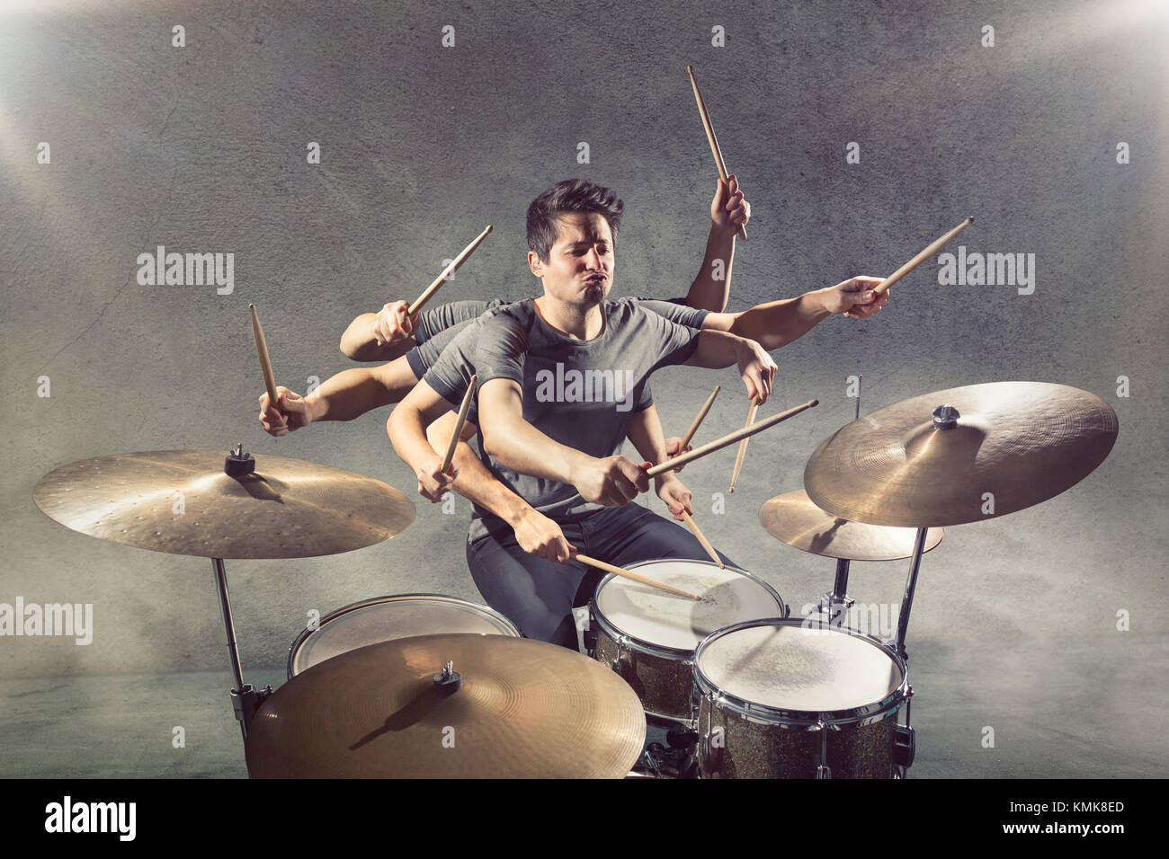 Drummer with many arms - Stock Image