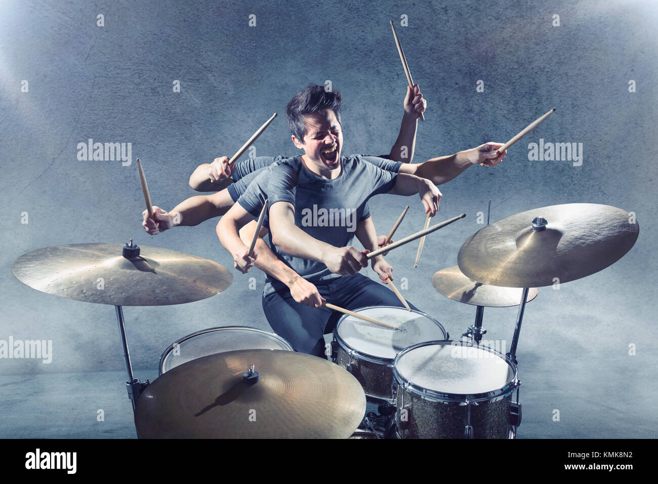 Drummer with multiple arms - Stock Image