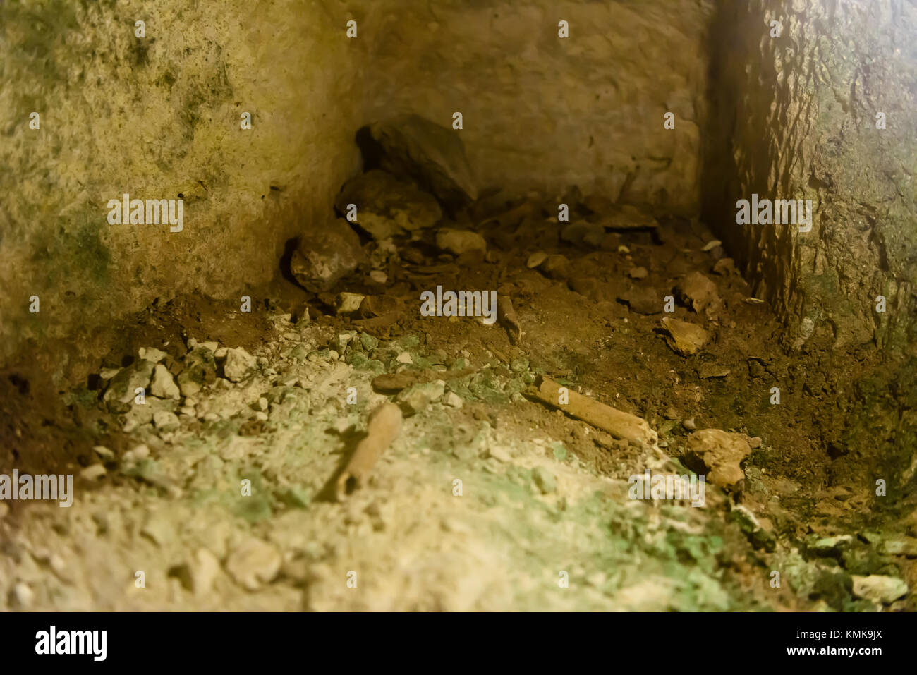 Crypt in St. Paul's underground catacombs, Mdina, Malta, with human remains Stock Photo