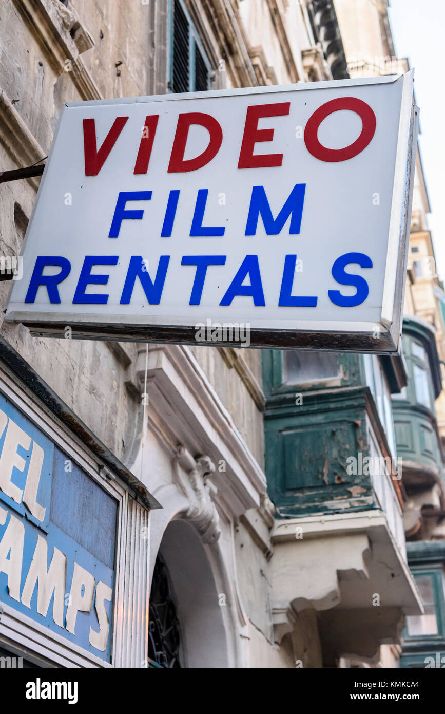 Sign outside a shop offering video film rentals - Stock Image