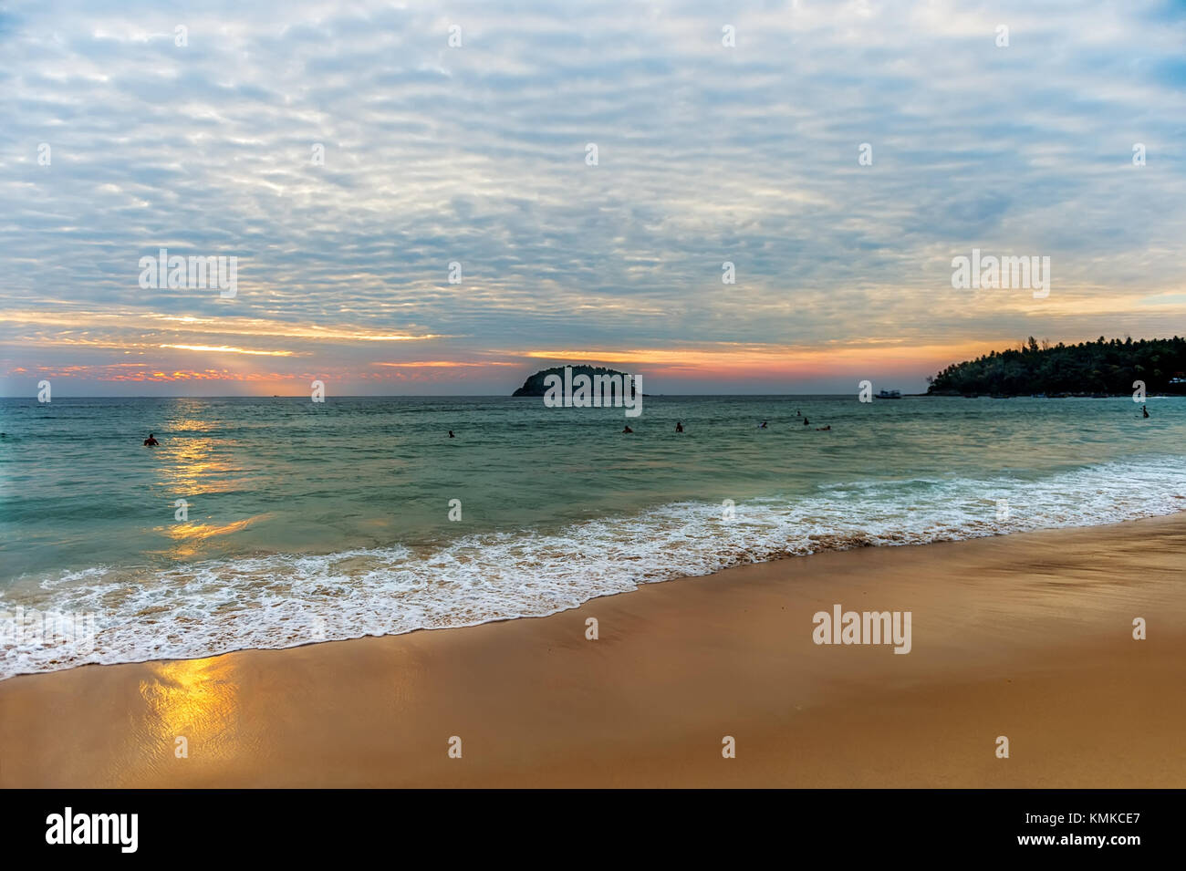 The beautiful scenery of the ocean at sunset with a wave on the shore. The horizontal frame. - Stock Image