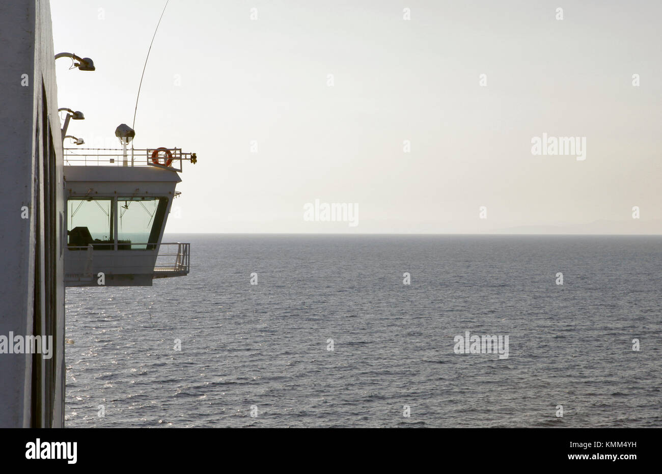 a view from a ferry on the mediterranean sea heading to the port of barcelona, spain with the ships bridge in view, - Stock Image