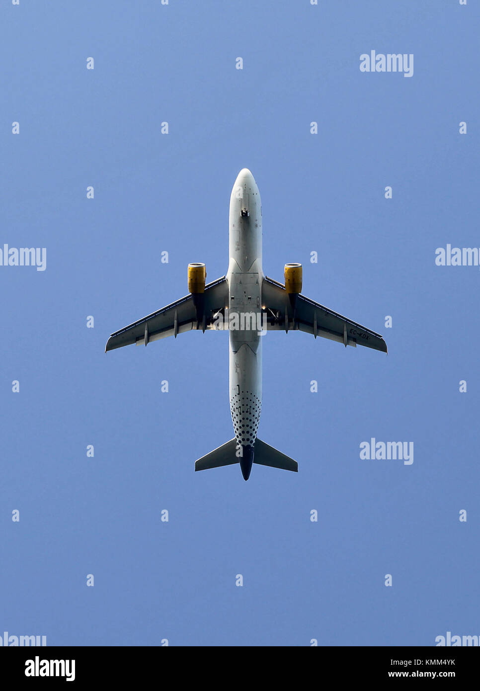 Underneath of an Vueling aeroplane in flight, after take off, Barcelona, Spain - Stock Image