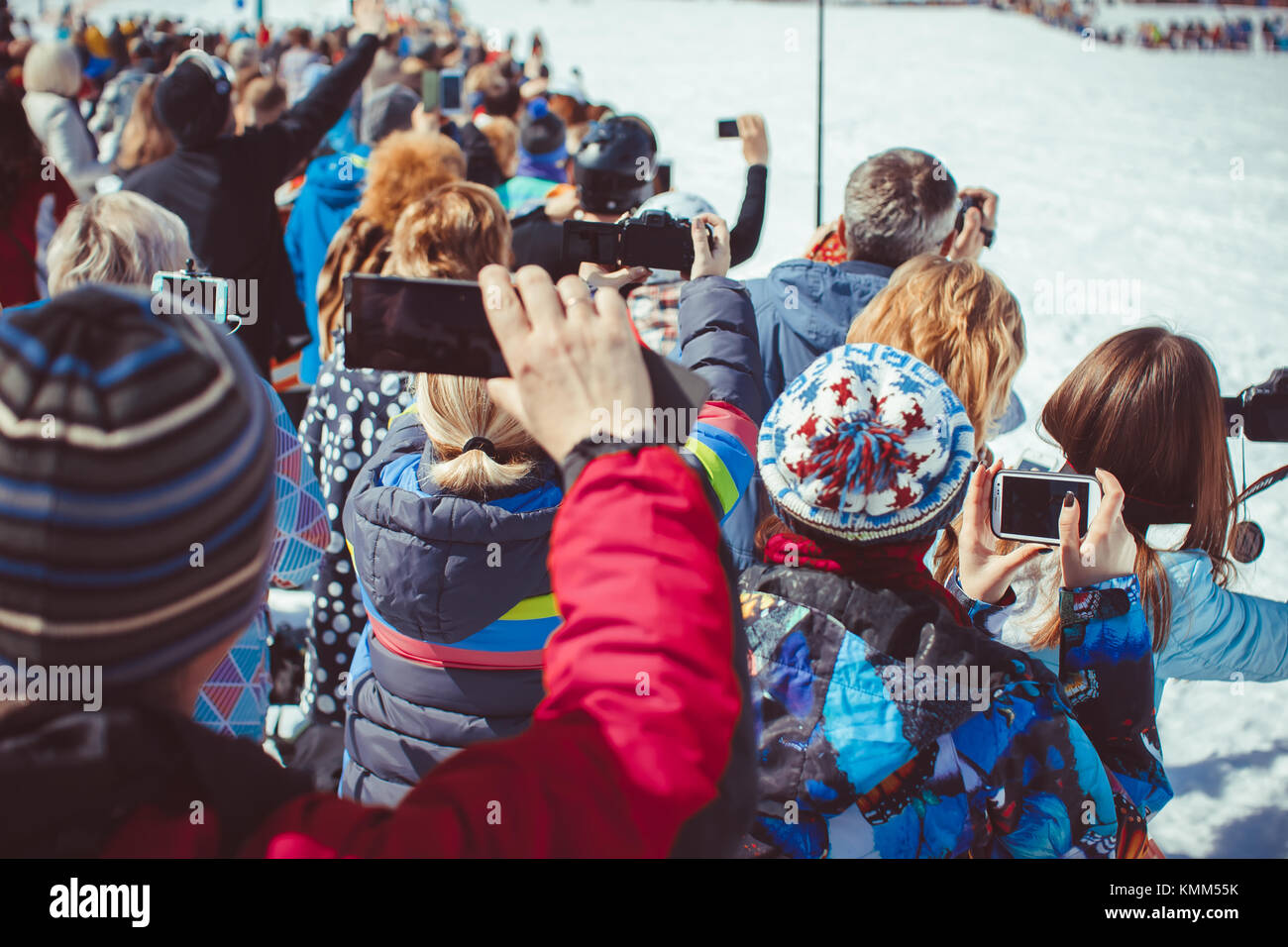 Sheregesh, Kemerovo region, Russia - April 16, 2016: Close up of recording video with smartphone during a ski descent - Stock Image