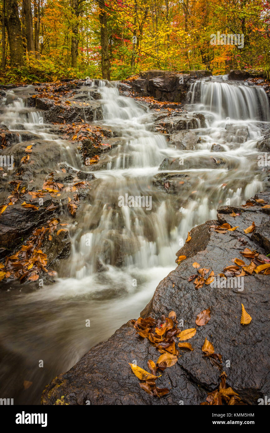 Small waterfalls in the fall - Stock Image