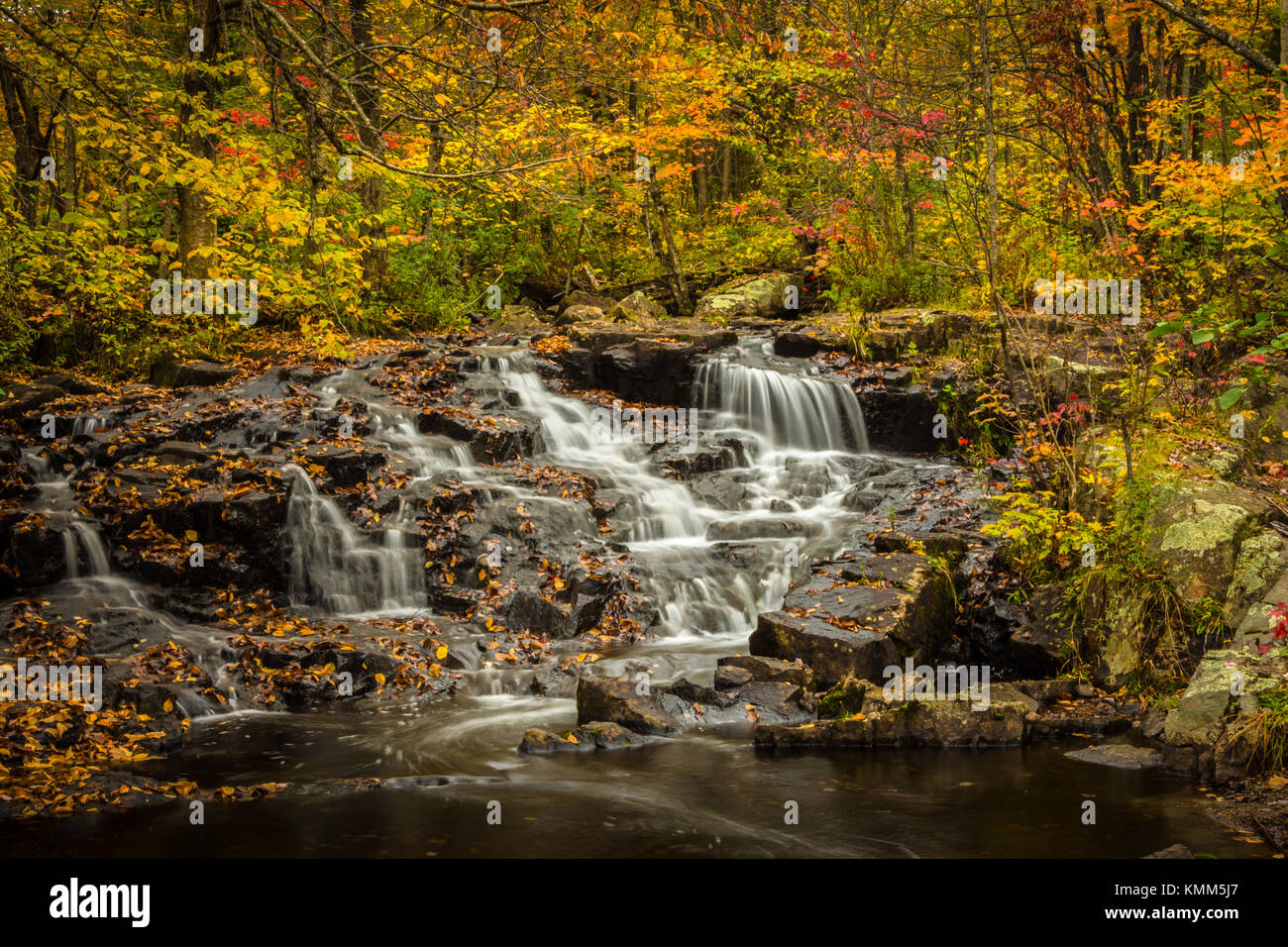 Small waterfalls in the fall 2 - Stock Image