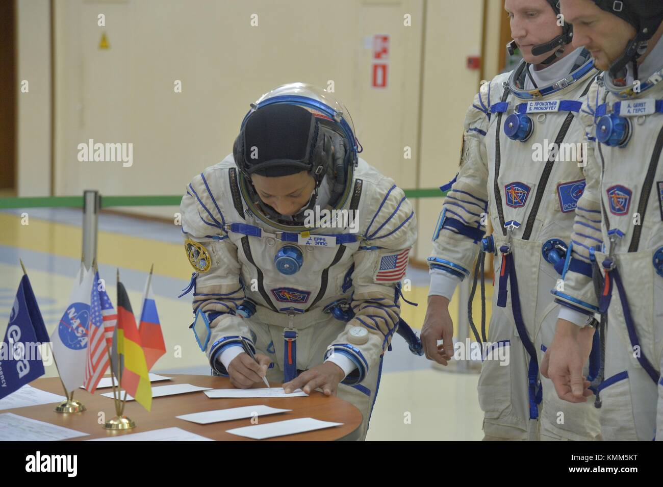 NASA International Space Station Expedition 54-55 backup crew member American astronaut Jeanette Epps (left) signs - Stock Image