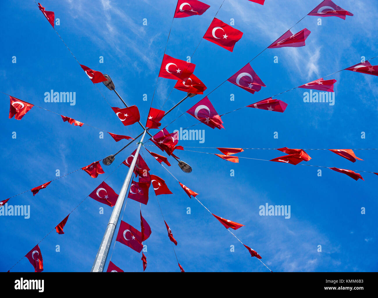 Mast with small turkish national flags against blue sky, Kaleici, old town of Antalya, turkish riviera, Turkey - Stock Image