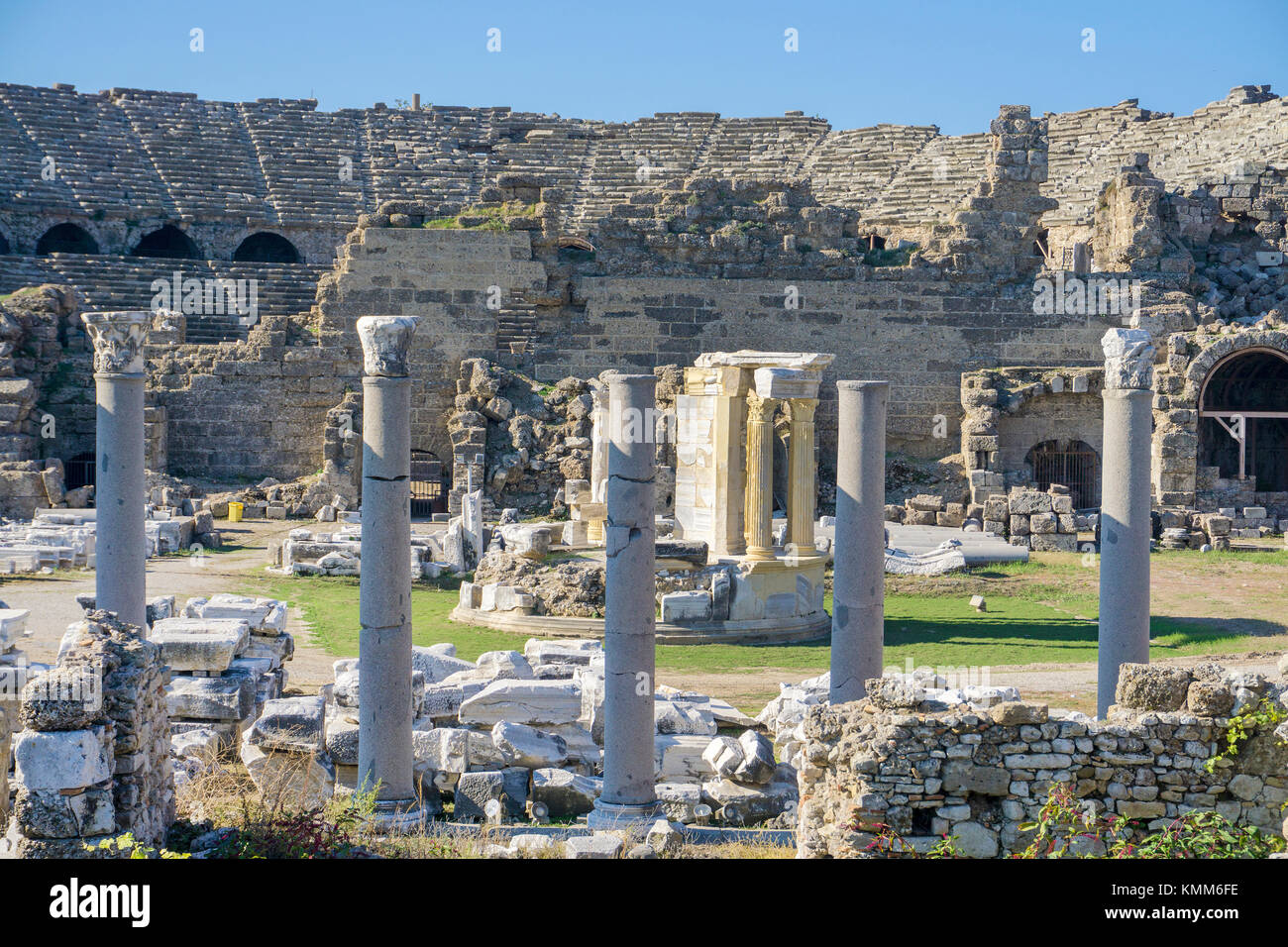 Temple of Tyche and amphi theatre, remainings of ancient Side, Manavgat province, turkish riviera, Turkey - Stock Image
