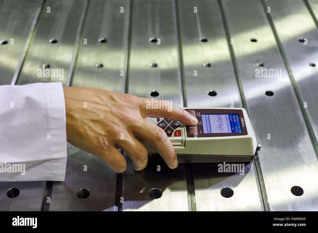 Quality control technician, Checking the roughness. Profilometer, Gipuzkoa, Basque Country, Spain, Europe - Stock Image