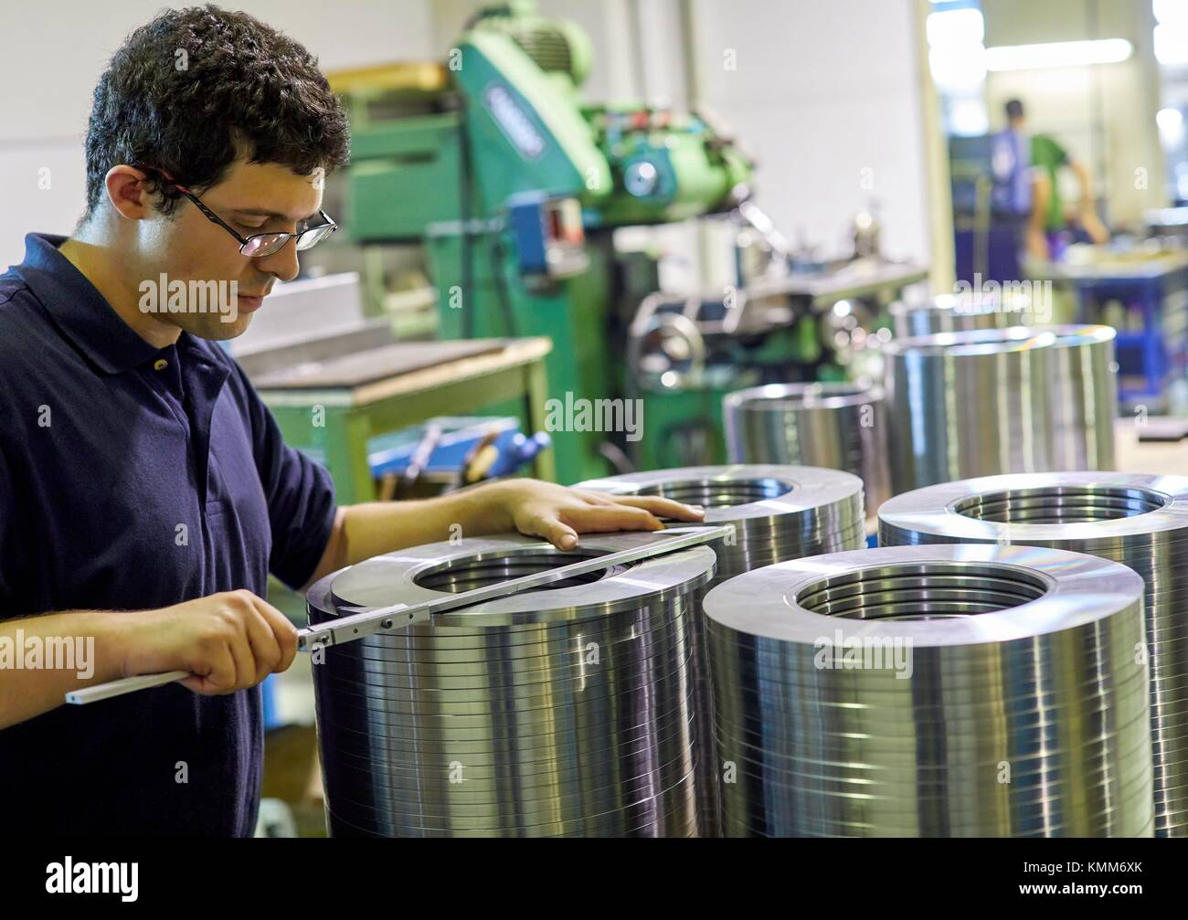 Quality control technician, Checking the measurement with caliper, Mechanical industry, Gipuzkoa, Basque Country, - Stock Image