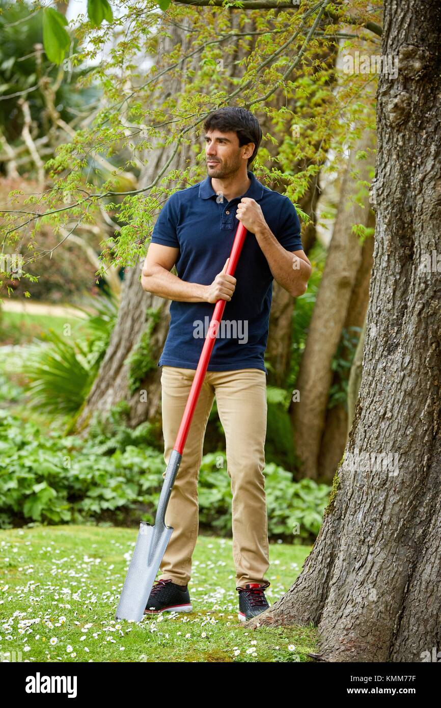 Gardener with hand tool, Garden, Digging shovel, Aiete Park, Donostia, San Sebastian, Gipuzkoa, Basque Country, - Stock Image