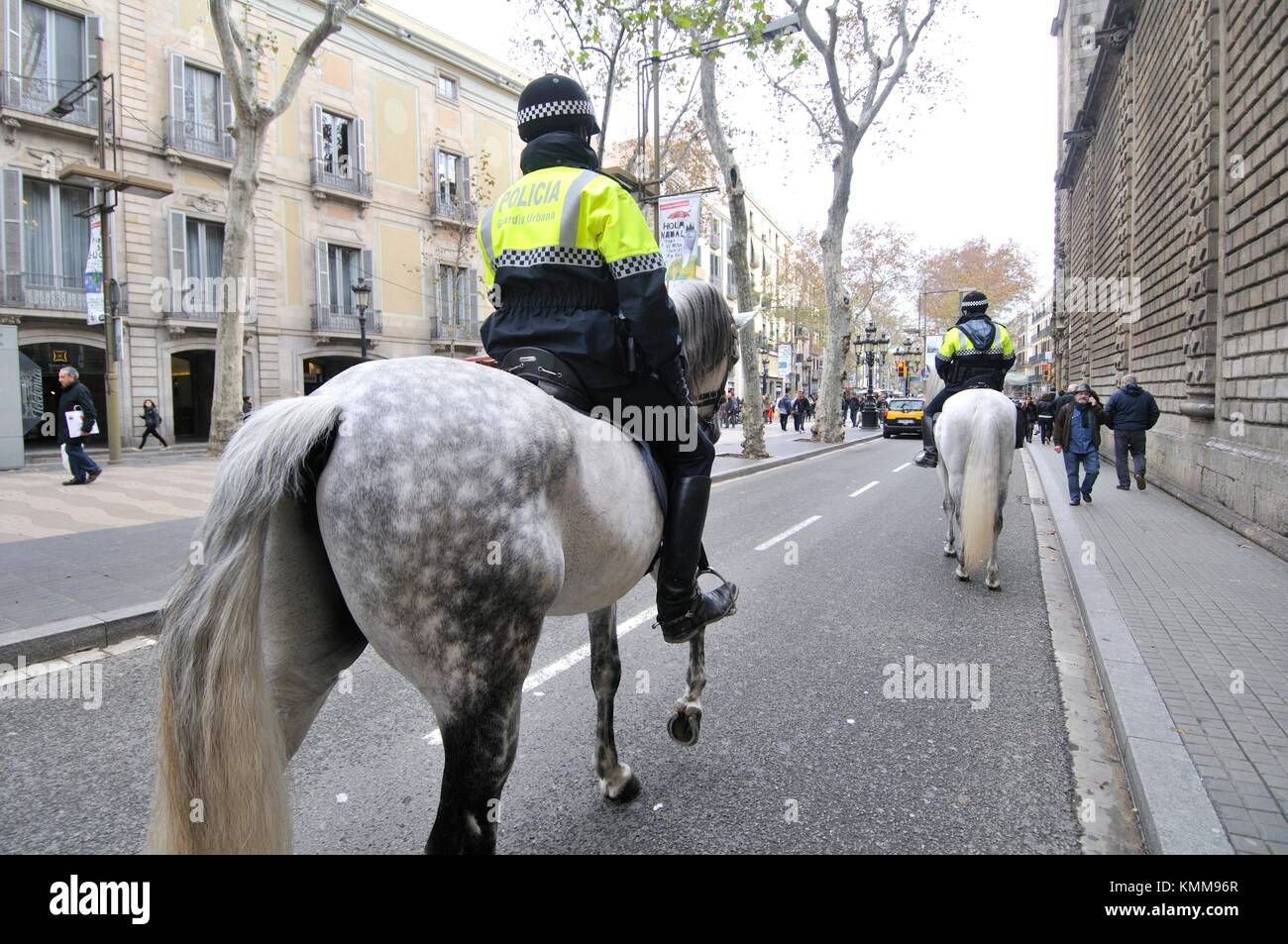 Guardia urbana, Urban guard, Municipal police on horseback. La Rambla. Barcelona, Catalonia, Spain. - Stock Image