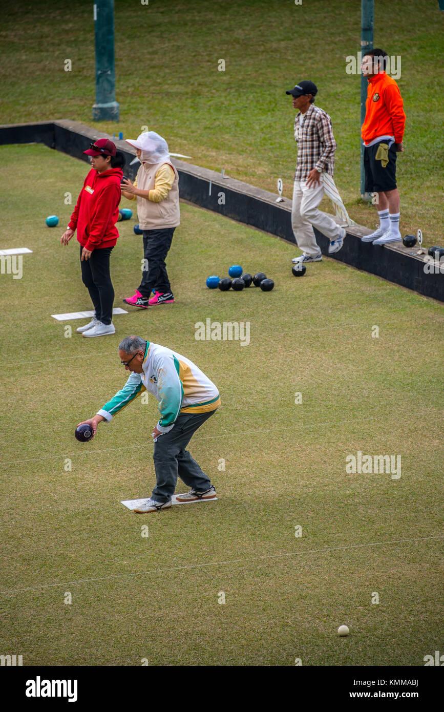 Playing Bowls, Sports Club, Hong Kong - Stock Image