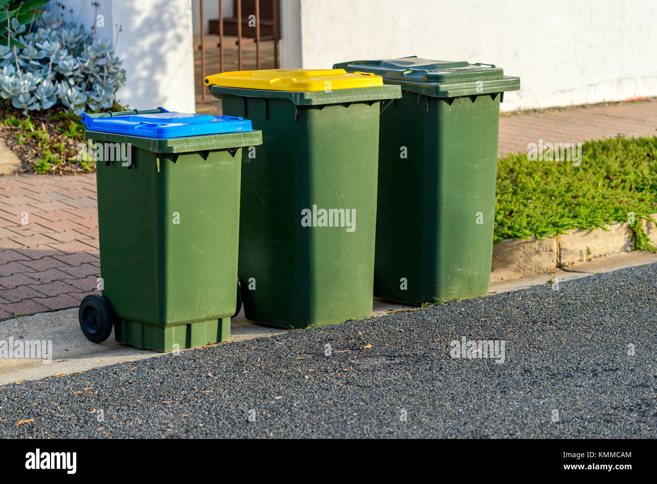 Kerbside waste bins ready for collection by local council in Australian suburb Stock Photo