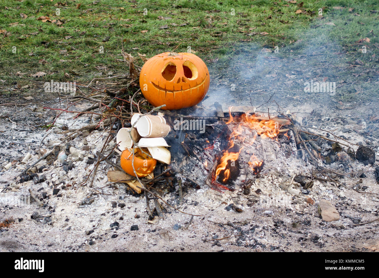 UK. Pumpkins and other litter being burned the morning after a Halloween party - Stock Image