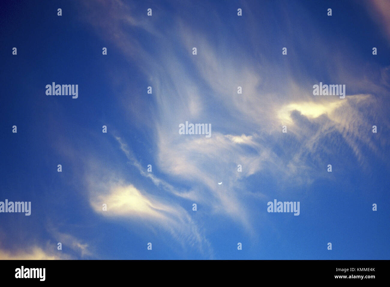 Wispy white clouds on blue sky. - Stock Image