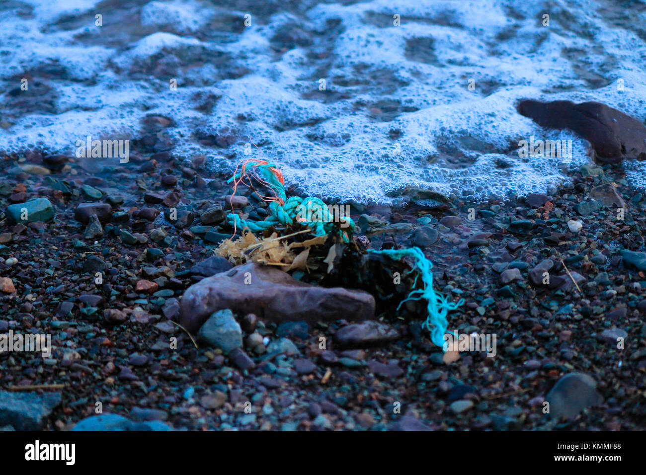 Washed up rope,where did it come from? - Stock Image