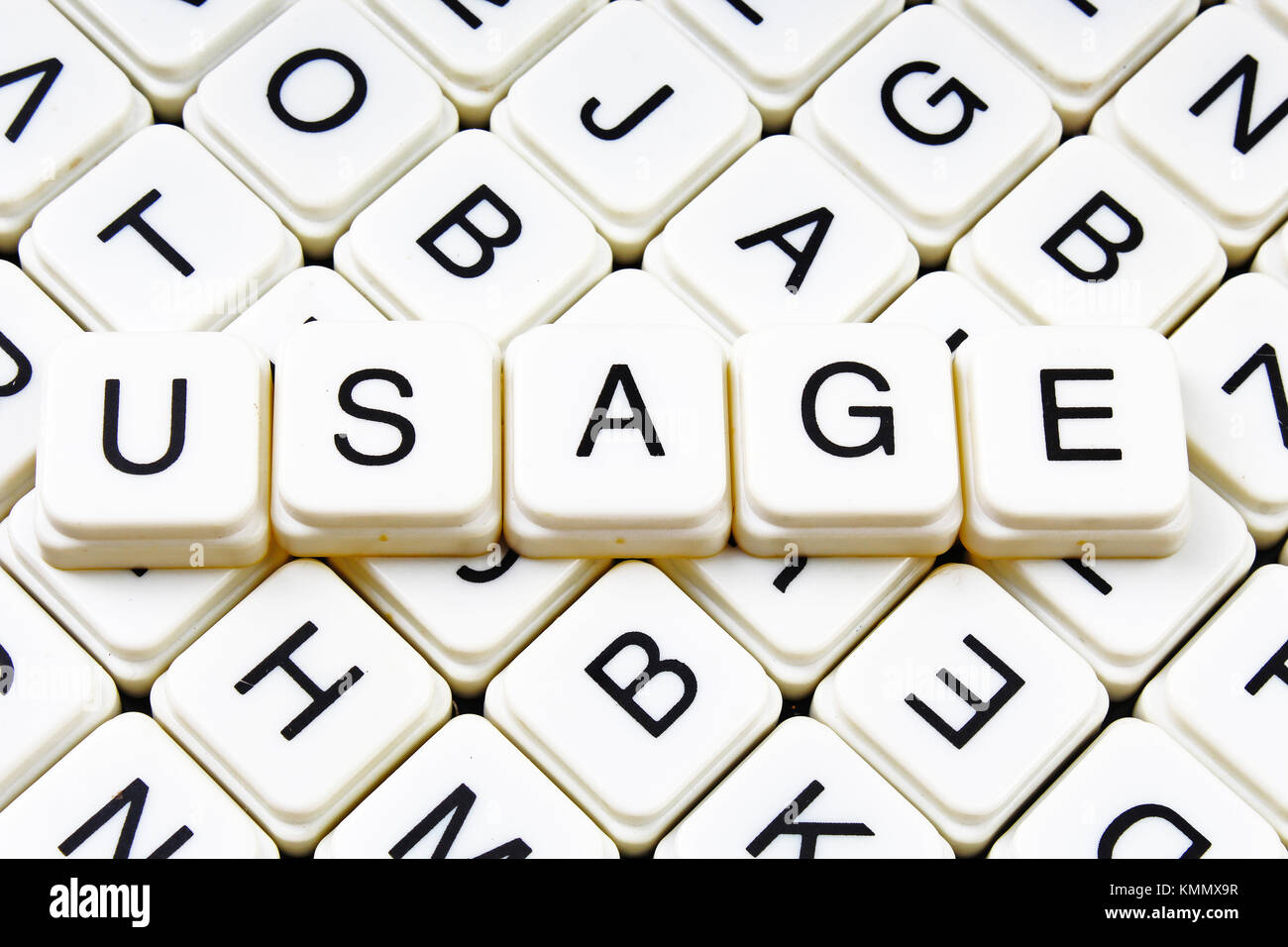 usage,title text word crossword. Alphabet letter blocks game texture background. White alphabetical letters on black - Stock Image