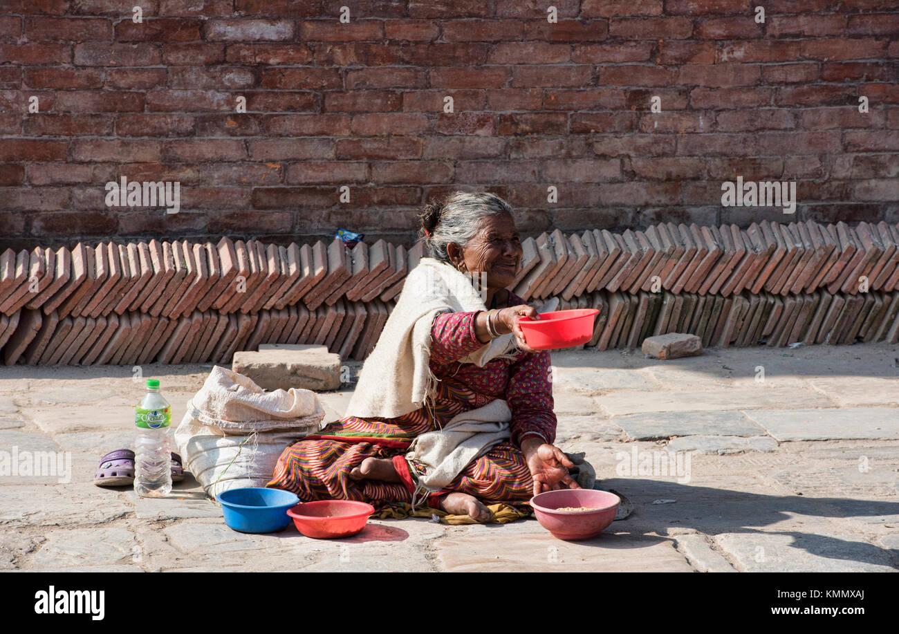 A beggar in Durbar Square, Kathmandu, Nepal - Stock Image