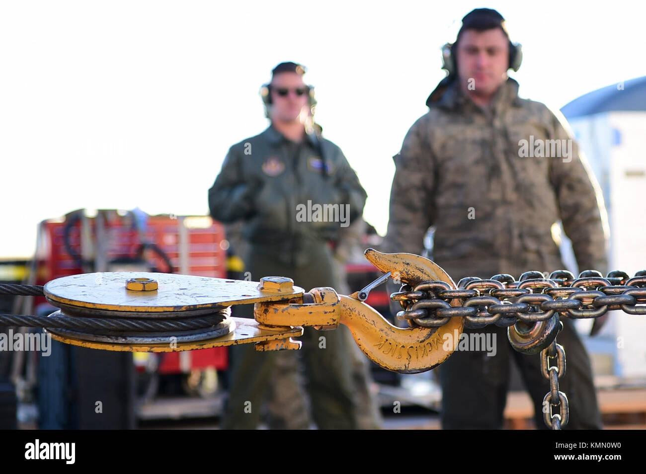 Airmen from the 337th Airlift Squadron look on as a wench is used to tow the Geostationary Operational Environmental - Stock Image