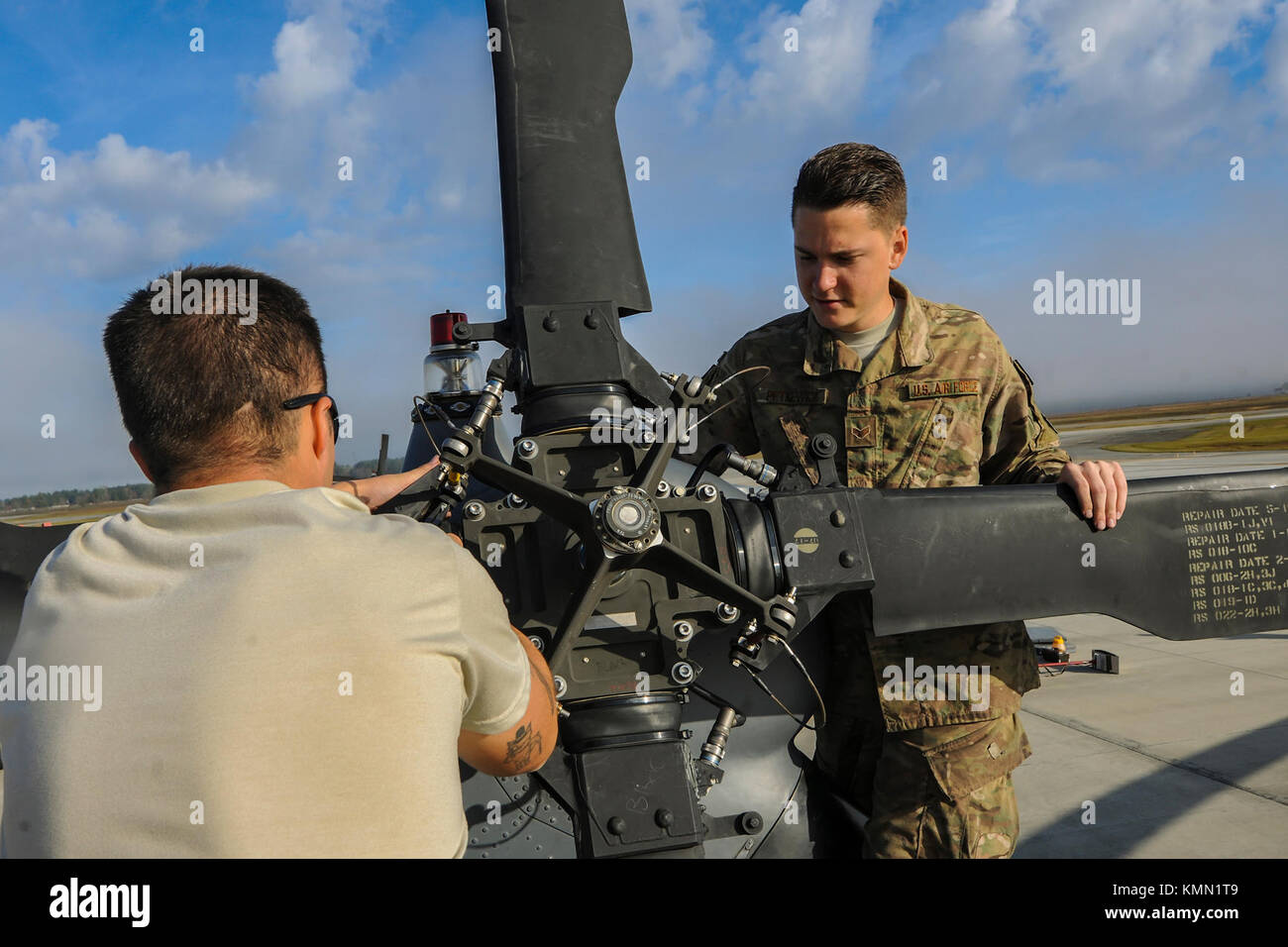 Senior Airman Greggory Petkewicz And Trevor Krutch 723d Aircraft Maintenance Squadron Crew Chiefs Work On The Rotor Of An HH 60G Pave Hawk