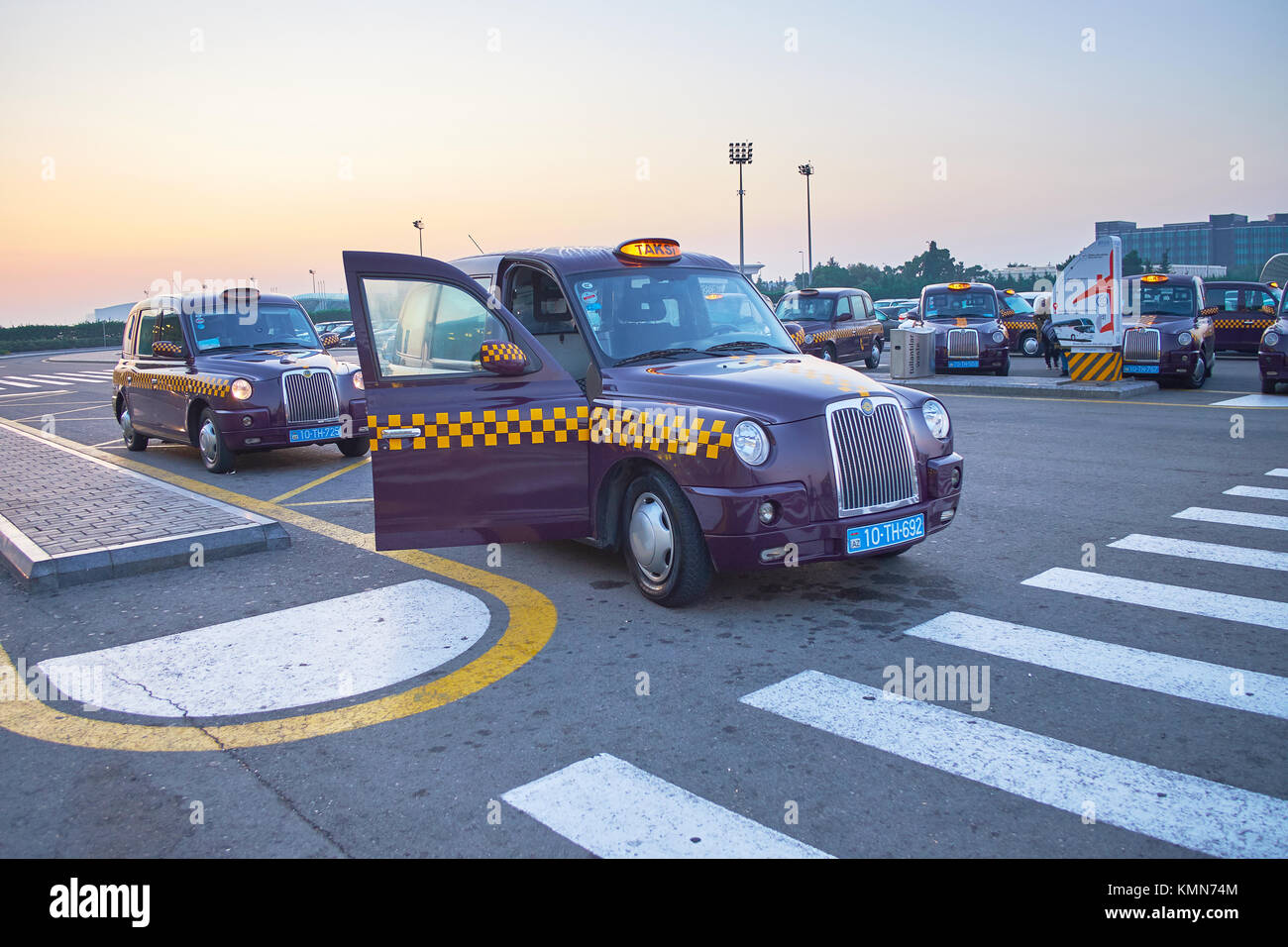 BINA, AZERBAIJAN - OCTOBER 9, 2017: Classic London cabs in Heydar Aliyev Airport are the most unexpected meet in - Stock Image