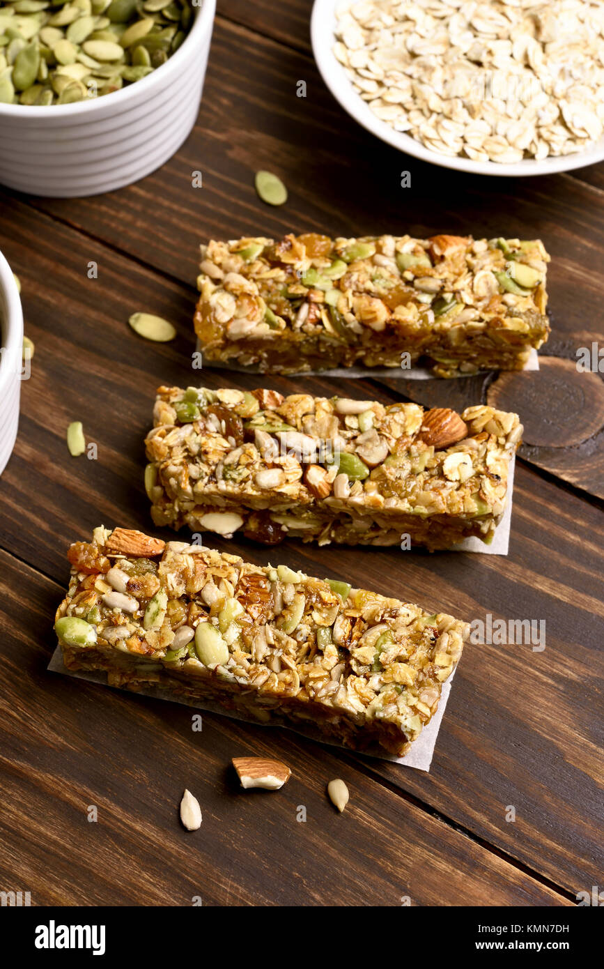 No baked granola bar on wooden table. Healthy breakfast. Energy snack - Stock Image