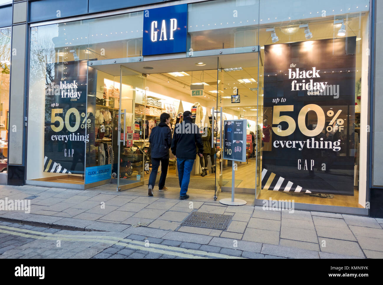 Black Friday signs on GAP shop store window England UK United Kingdom GB Great Britain - Stock Image