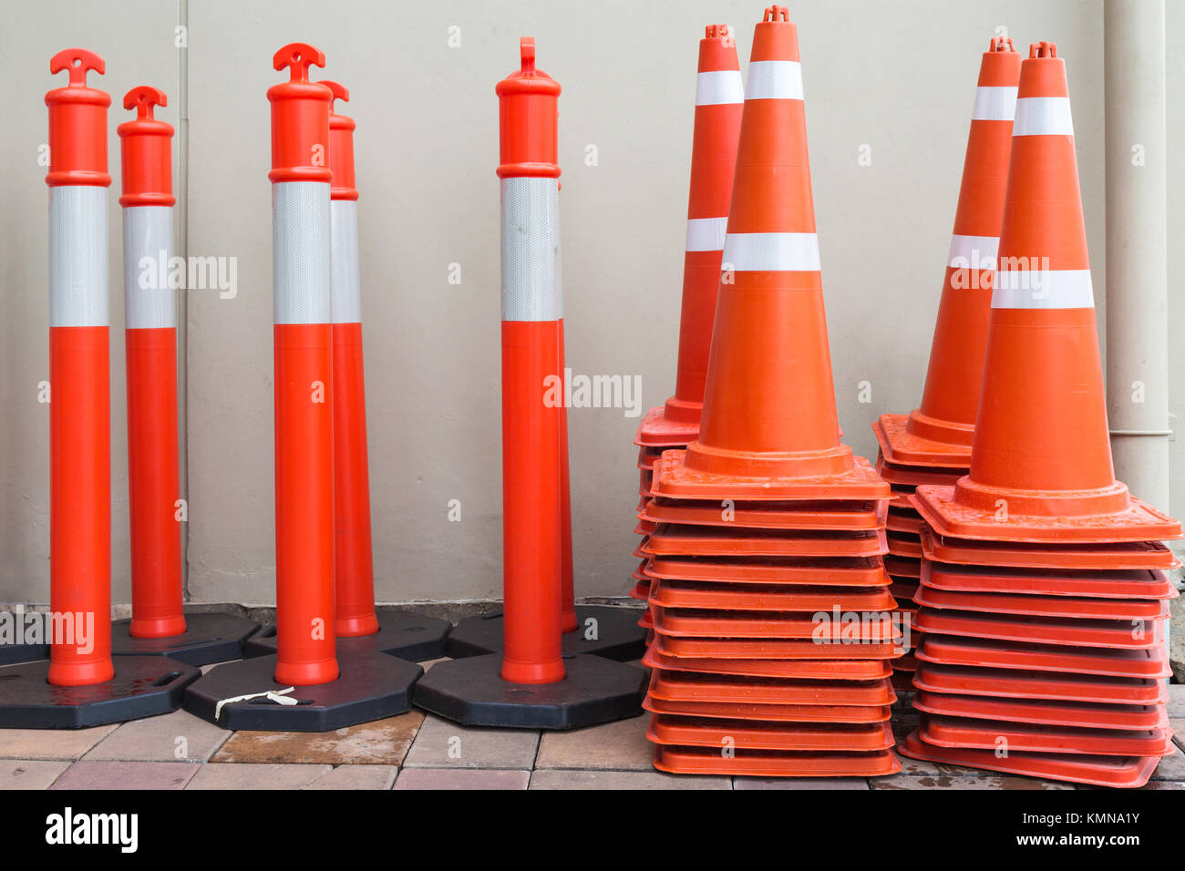 orange traffic cones and orange traffic poles ready to used on the - Stock Image