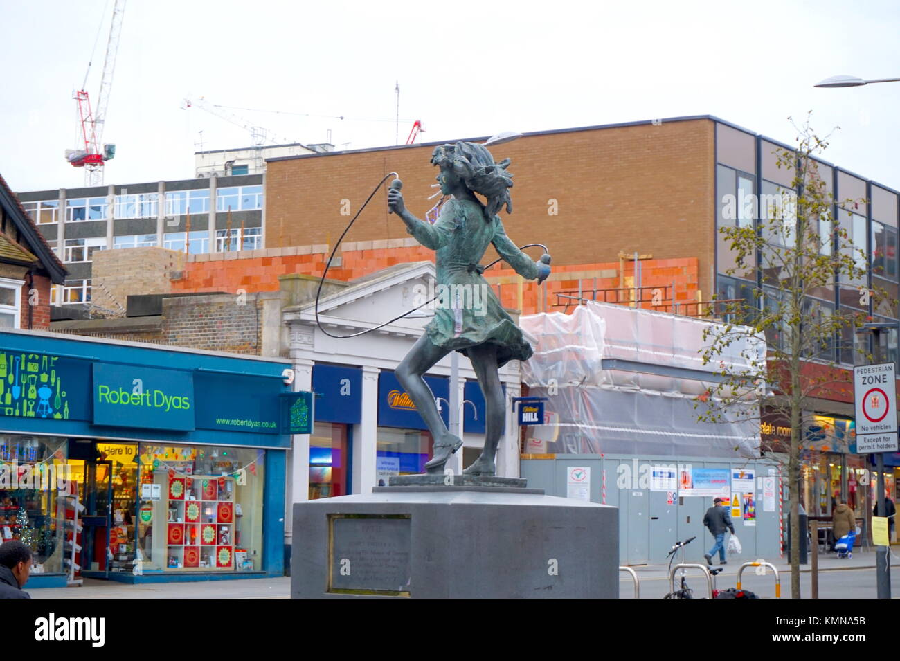Statue of the skipping girl in Harrow shopping centre, Station Road, London, United Kingdom - Stock Image