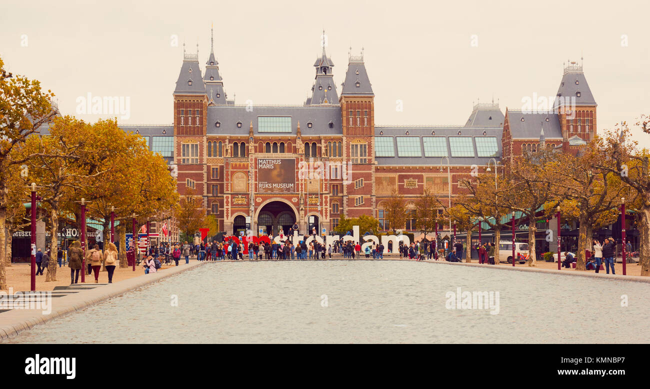 Tourists and the I Amsterdam giant letters marketing slogan with Rijksmuseum behind, Museumplein, (Museum Square), - Stock Image