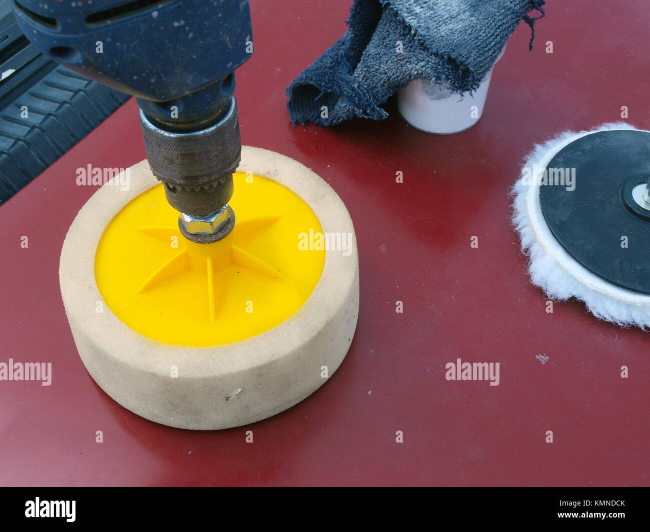 Polishing car body painting by foam rubber disk and electric drill