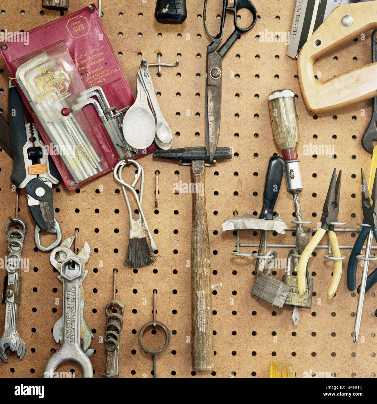 Tools hanging on pegboard - Stock Image