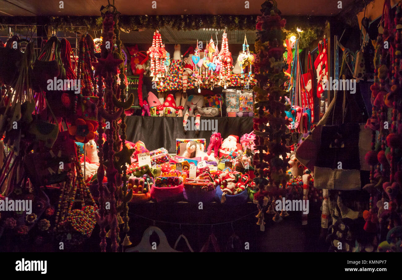 A Christmas market stall selling purses, Christmas decorations & novelties made out of felt at Edinburgh's Christmas Stock Photo