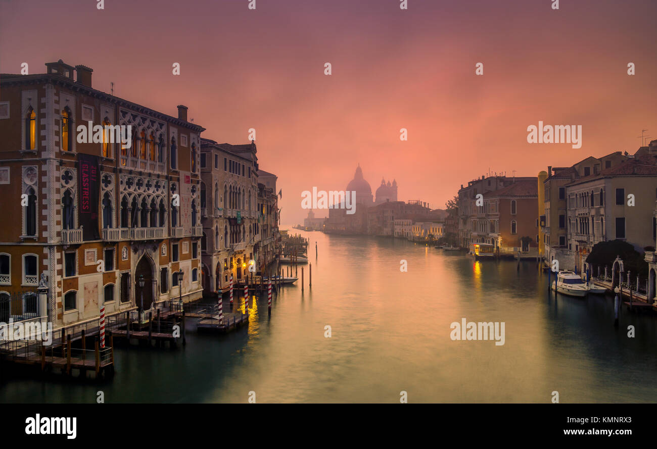 View on Venice: an early morning view from the Accademia Bridge in the mist, towards the church Santa Maria della - Stock Image