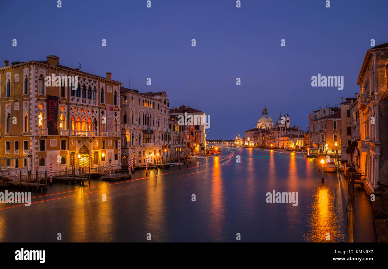 View on Venice: a view at dusk over the Canal Grande from the Accademia Bridge towards the church Santa Maria della Stock Photo