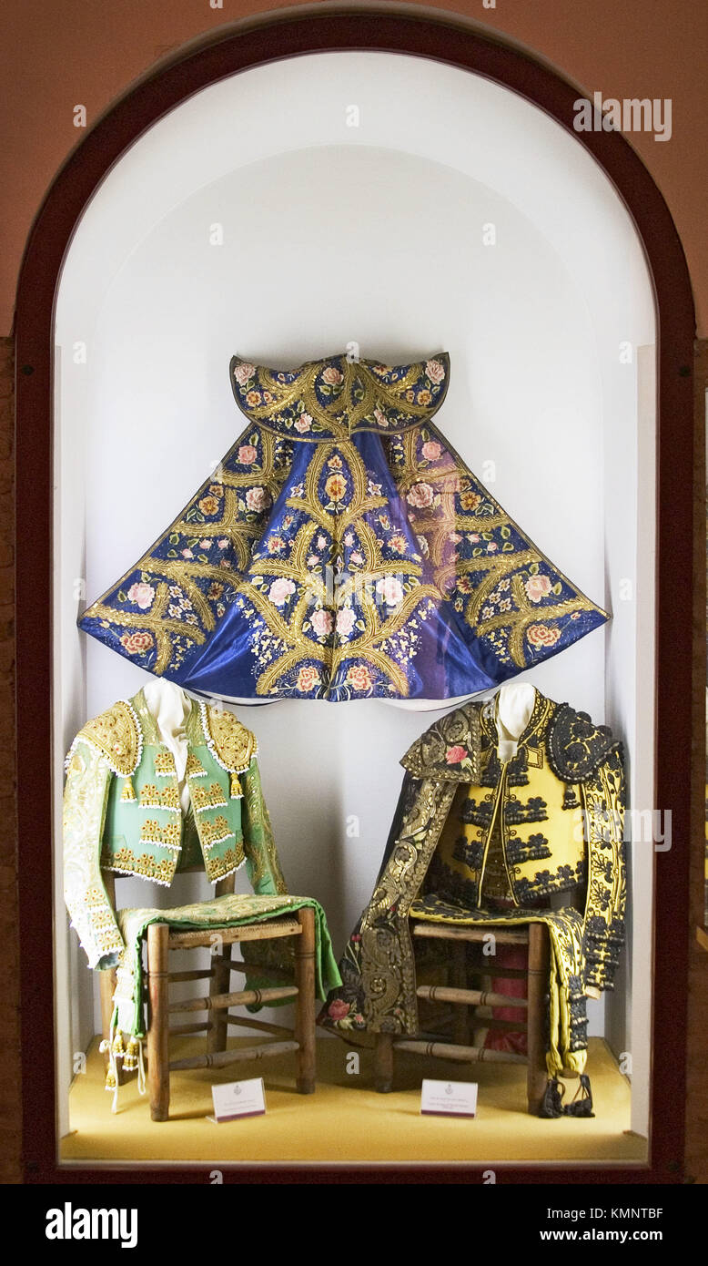 Bullfighter costumes and ´capote´ in Maestranza bullring museum. Seville. Andalusia, Spain Stock Photo