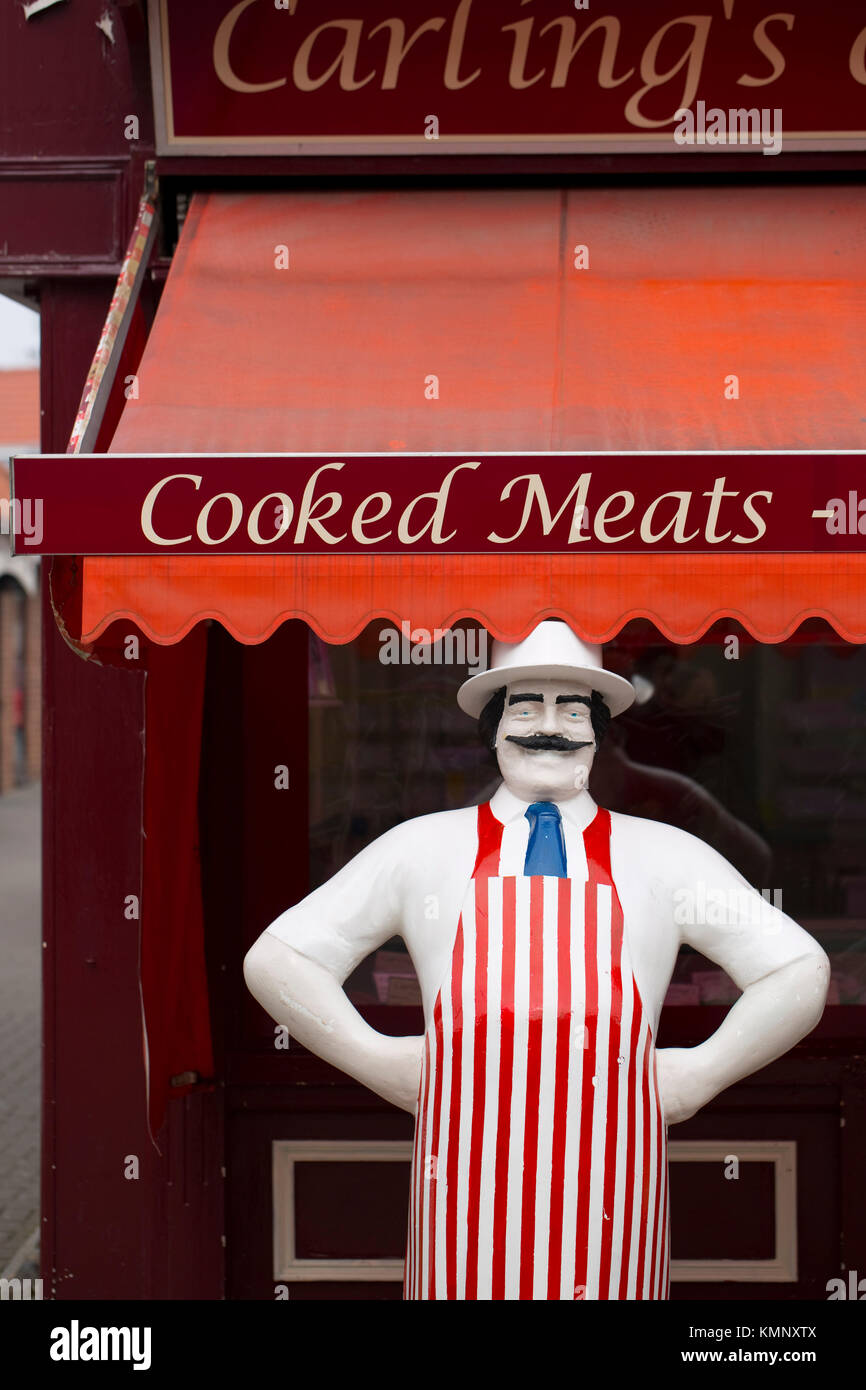 Life Size Butcher model outside a traditional butchers in the market town of Beverely, East Yorkshire, UK - 31st - Stock Image