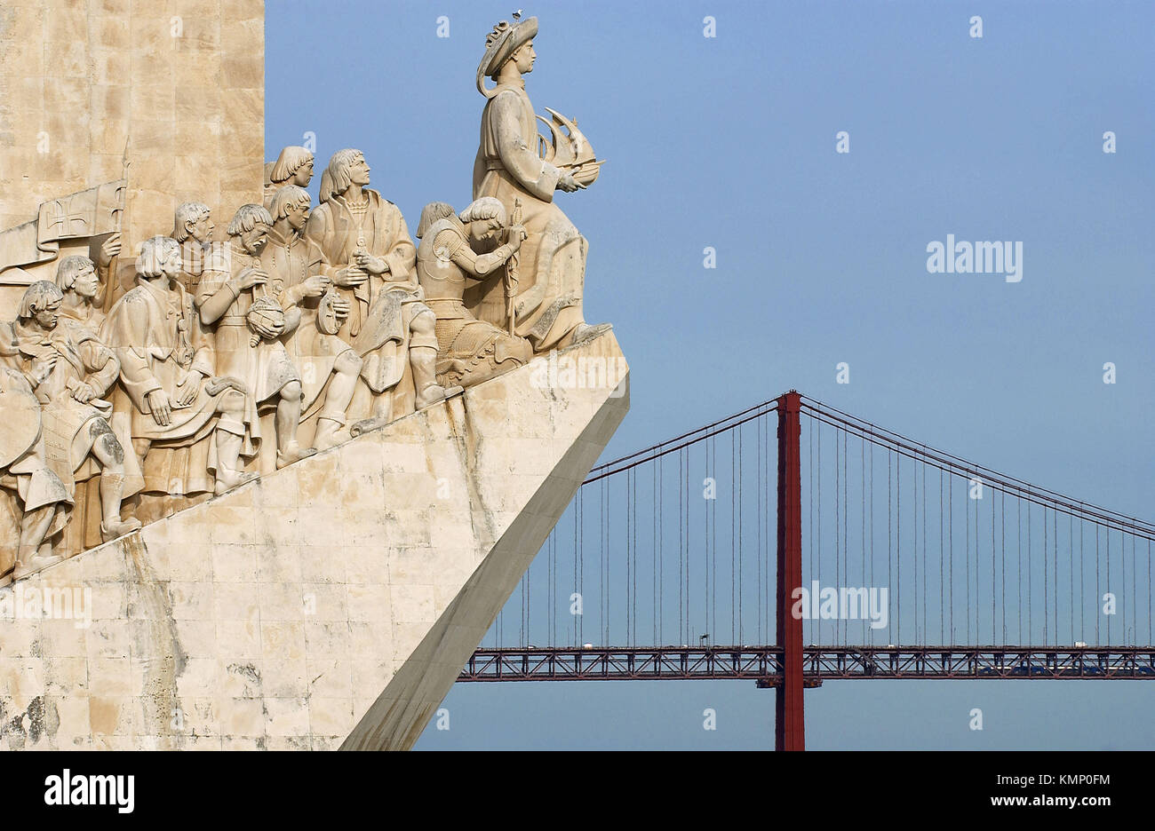 Monument to the Discoveries and April 25 Bridge, Lisbon. Portugal - Stock Image