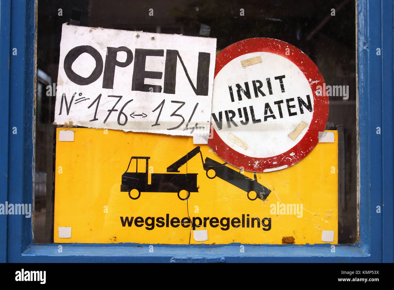 Traffic signs forbidding entry and threatening towaway. Holland - Stock Image