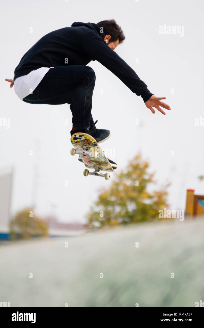 a young boy jumping with skateboard------- Imperia, IM, Liguria, Italy - October 26, 2016: A young boy jumping on - Stock Image
