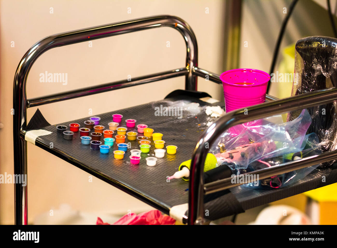 Colors and tools used for tattooing, ink and needles sterilized instruments. - Stock Image