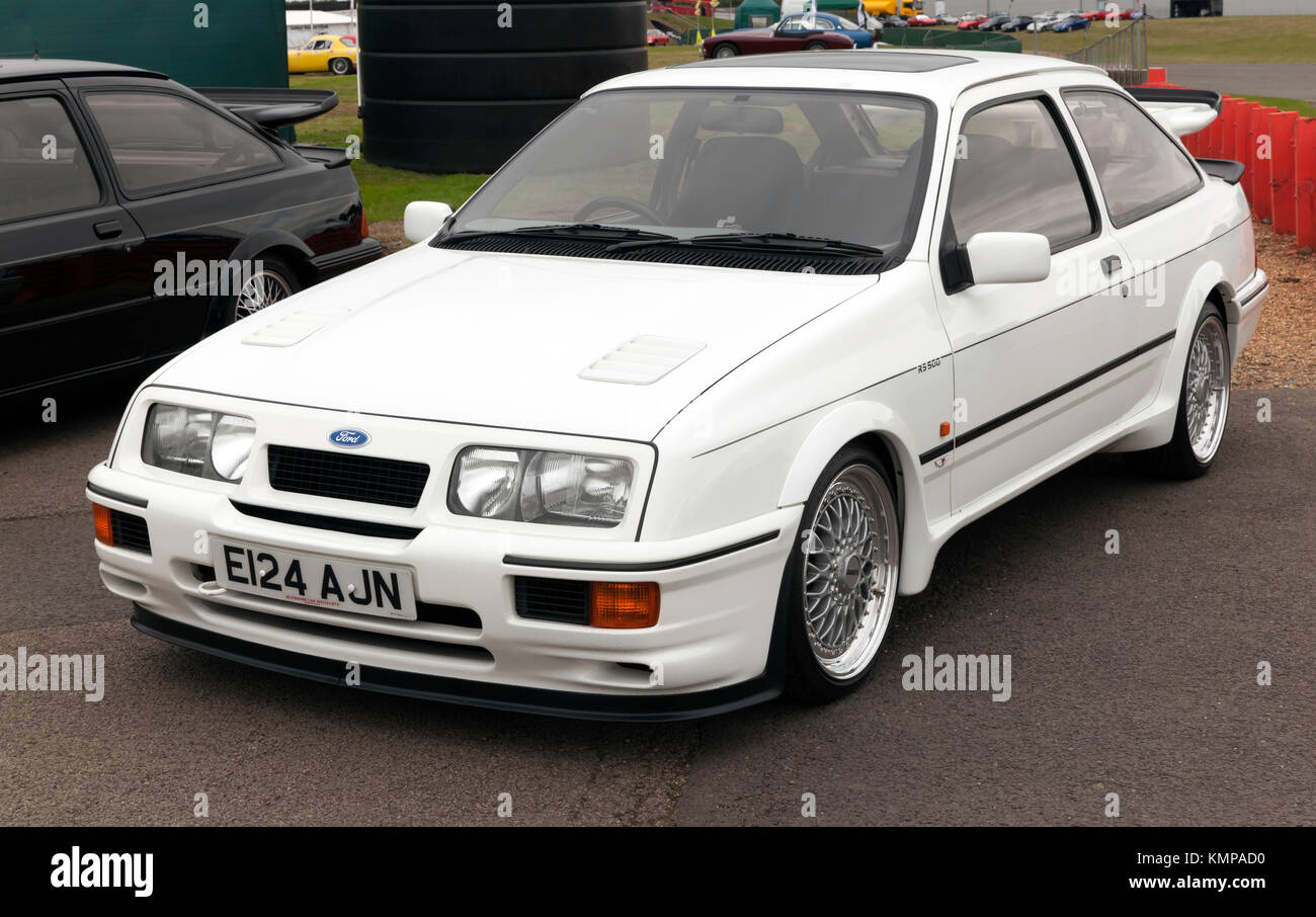 Three-quarter  front view of a 1987 Ford Sierra RS500,  on display in the club zone of the 2017 Silverstone Classic - Stock Image