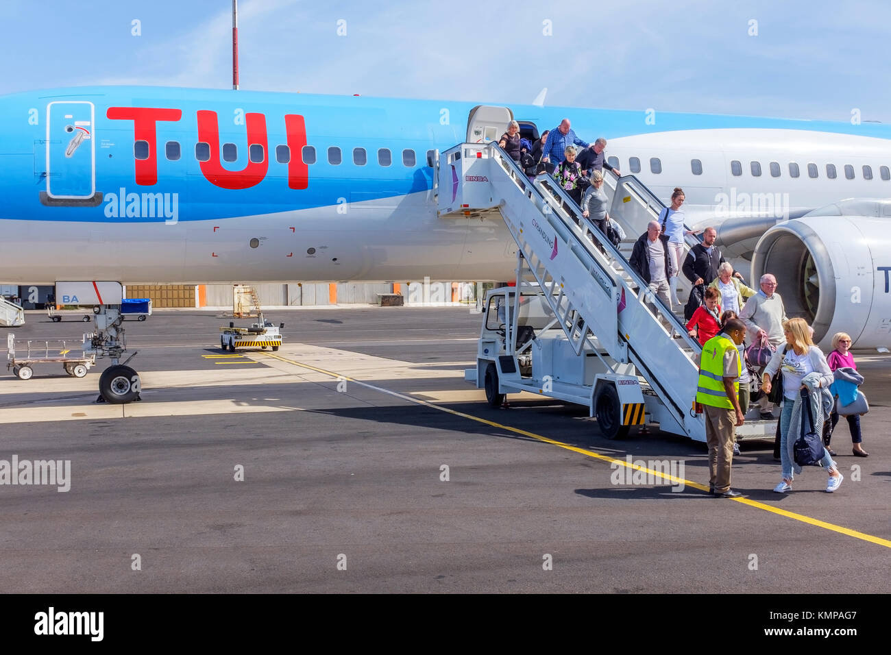 British tourists disembarking from a TUI travel company Boeing 757 200 jet at Amilar Cabral International Airport, - Stock Image