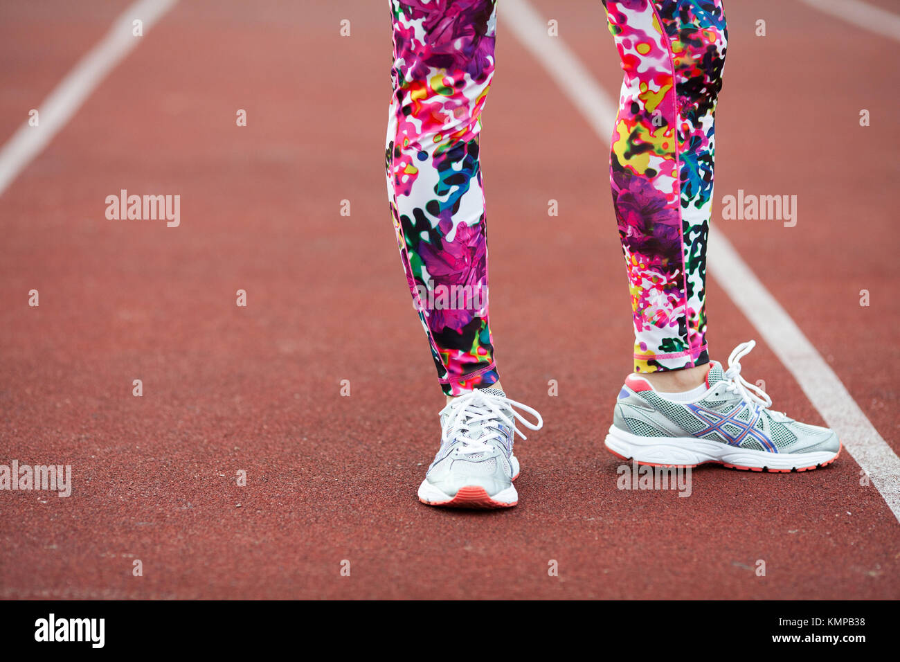 df9d7217d Legs sports girl in bright tights and grey sneakers on the Jogging path.  Woman warming